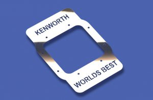 """KENWORTH WORLD'S BEST"" Cutout Shifter Base Plate 1"